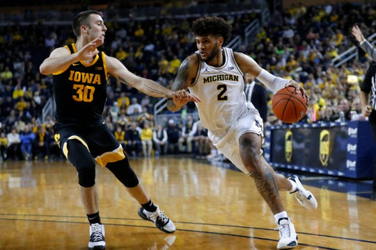 Iowa's Connor McCaffery (left) has been asked to guard a variety of big-time scorers this season, such as MIchigan's Isaiah Livers here. On Saturday, it will be Penn State forward Lamar Stephens, three inches taller than McCaffery.