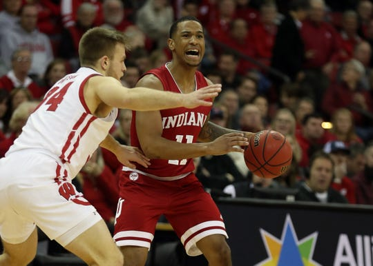 Dec 7, 2019; Madison, WI, USA; Indiana Hoosiers guard Devonte Green (11) controls the ball against Wisconsin Badgers guard Brad Davison (34) during the first half at the Kohl Center. Mandatory Credit: Mary Langenfeld-USA TODAY Sports