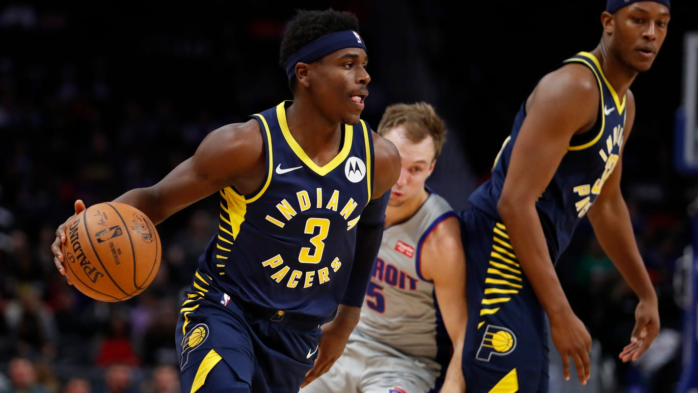 Holiday brothers take over fourth quarter for Pacers in comeback win over Celtics