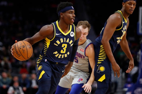 Indiana Pacers guard Aaron Holiday (3) dribbles the ball during the first quarter against the Detroit Pistons at Little Caesars Arena.