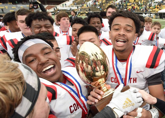The Corinth Warriors celebrate with the Class 4A at the MHSAA State Football Championship at M.M. Roberts Stadium on the University of Southern Mississippi campus in Hattiesburg on Saturday, December 7, 2019.