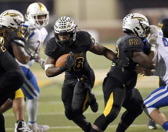 Oak Grove's Nick Milsap (28) runs against Oxford in the MHSAA Class 6A State Football Championship at M.M. Roberts Stadium on the University of Southern Mississippi campus in Hattiesburg on Friday, December 6, 2019.