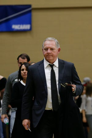 Purdue athletic director Mike Bobinski walks into Holloway Gymnasium before the first set during a first round match of the NCAA Div I Women's Volleyball Championships, Friday, Dec. 6, 2019 in West Lafayette, Ind.