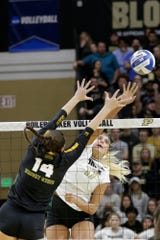 Purdue middle blocker Blake Mohler (17) spikes the ball past Wright State middle blocker Teddie Sauer (14) in the second set during a first round match of the NCAA Div I Women's Volleyball Championships, Friday, Dec. 6, 2019 in West Lafayette, Ind.
