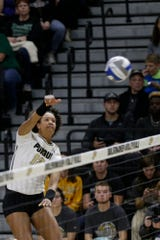 Purdue outside hitter Emma Ellis (12) spikes the ball in the second set during a first round match of the NCAA Div I Women's Volleyball Championships, Friday, Dec. 6, 2019 in West Lafayette, Ind.