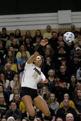 Purdue outside hitter Emma Ellis (12) hits the ball in the first set during a first round match of the NCAA Div I Women's Volleyball Championships, Friday, Dec. 6, 2019 in West Lafayette, Ind.