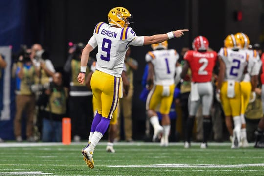 Dec 7, 2019; Atlanta, GA, USA; LSU Tigers quarterback Joe Burrow (9) reacts after throwing a touchdown pass against the Georgia Bulldogs during the first quarter in the 2019 SEC Championship Game at Mercedes-Benz Stadium. Mandatory Credit: Dale Zanine-USA TODAY Sports