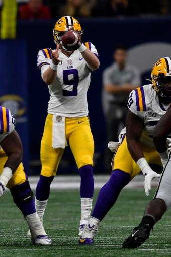 LSU quarterback Joe Burrow (9) works against Georgia during the first half of the Southeastern Conference championship NCAA college football game, Saturday, Dec. 7, 2019, in Atlanta. (AP Photo/John Amis)