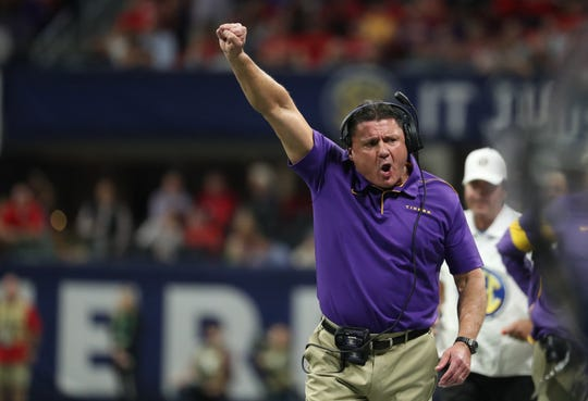 Dec 7, 2019; Atlanta, GA, USA; LSU Tigers head coach Ed Orgeron reacts after a catch by wide receiver Terrace Marshall Jr. (not pictured) in the first quarter against the Georgia Bulldogs in the 2019 SEC Championship Game at Mercedes-Benz Stadium. Mandatory Credit: Jason Getz-USA TODAY Sports