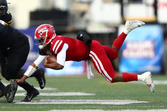 Dec 7, 2019; Boone, NC, USA; Louisiana-Lafayette Ragin Cajuns quarterback Levi Lewis (1) dives against the Appalachian State Mountaineers during the third quarter at Kidd Brewer Stadium. Mandatory Credit: Jeremy Brevard-USA TODAY Sports