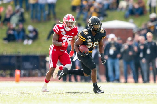 Dec 7, 2019; Boone, NC, USA; Appalachian State Mountaineers running back Marcus Williams Jr. (26) carries the ball against Louisiana-Lafayette Ragin Cajuns defensive back Terik Miller (38) during the first quarter at Kidd Brewer Stadium. Mandatory Credit: Jeremy Brevard-USA TODAY Sports