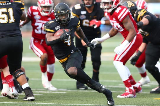 Appalachian State running back Daetrich Harrington (4) gains some yards on UL during Saturday's Sun Belt Conference championship game.