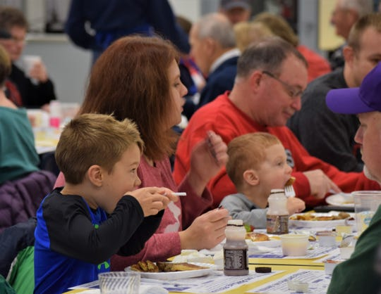 Youngsters chow down at the 61st Lancaster Kiwanis Club Pancake Festival held at Lancaster High School Dec. 7. The festival is the club's biggest fundraiser of the year.