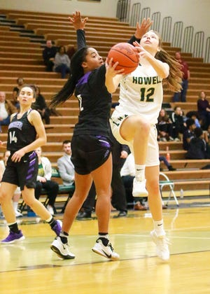 Howell freshman Molly Deurloo drives for the first basket of her career, tying the game temporarily in the fourth quarter of a 43-35 loss to Ann Arbor Pioneer on Friday, Dec. 6, 2019.