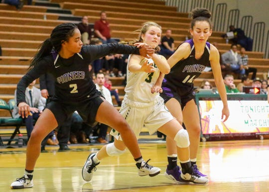 Howell's Sophie Daugard (3) battles for position with Ann Arbor's Ashanti Turman (2) and Mya Hicks (14) on Friday, Dec. 6, 2019.