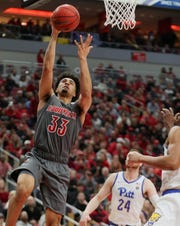 Jordan Nwora bounced back from an injury scare to score 19 points Friday.
