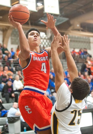 """""""I'm not a big fan of being undefeated. Obviously, you don't want to lose games, but at the same time, you need that push, that motivation to do it,"""" said Trey Kaufman, who was named the Holiday Tournament MVP."""
