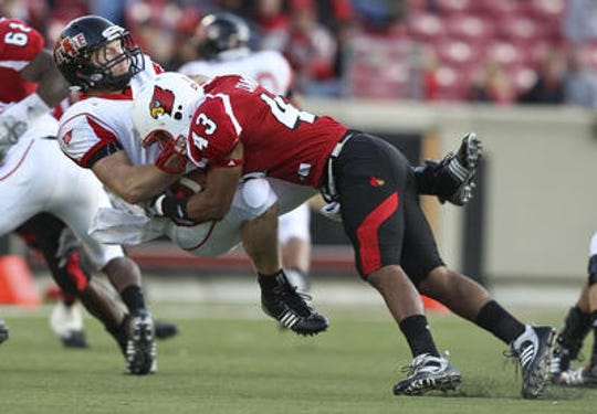 University of Louisville's Chris Campa puts a huge hit on Arkansas State's Corey Leonard during the Louisville-Arkansas State football game Saturday at Papa Johns Cardinal Stadium on Oct. 31, 2009. Campa was found dead Friday, Dec. 6, 2019, at a home in Orlando, Florida. He was 32 years old.