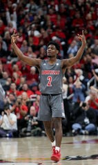 Louisville's Darius Perry celebrates after knocking down a shot against Pittsburgh on Dec. 6, 2019.