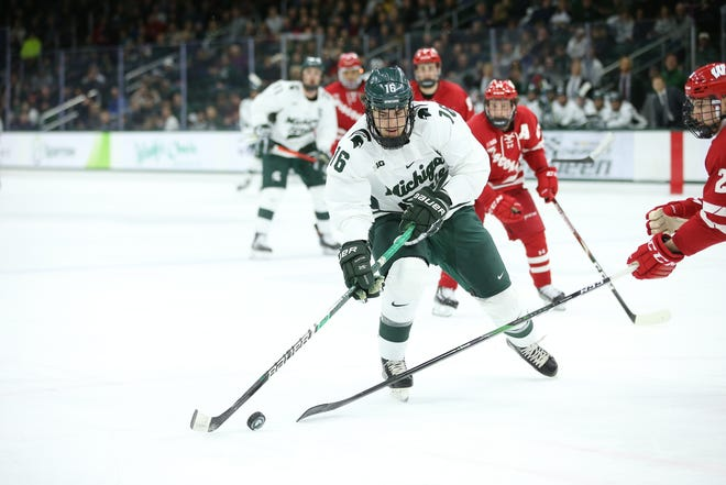 Michigan State forward Brody Stevens skates past a Wisconsin defender on Friday, December 6 at Munn Ice Arena. Stevens scored a goal in the Spartans' 3-0 win over the Badgers.