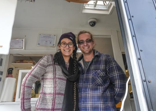 Jonathan Ristola and Christabelle Dozeman, shown Saturday, Dec. 7, 2019, are co-founders and owners of VEG-N, a mobile food truck providing vegan and vegetarian food. .