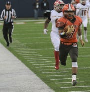 Mansfield Senior's Terrance Flickinger races off for a 94-yard touchdown run in the second half of the Tygers 14-7 overtime loss to Trotwood-Madison in the Division III state championship game on Friday night.