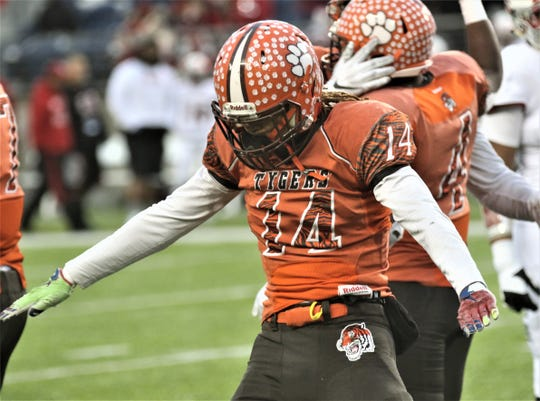 Mansfield Senior's Donovan Haney celebrates a sack during the Tygers Division III state runner-up game against Trotwood-Madison at Tom Benson Hall of Fame Stadium in Canton on Friday night.
