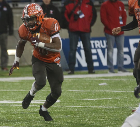 Mansfield Senior's Angelo Grose runs for a long gain during the Division III state championship game on Friday night.