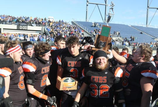 The Lucas Cubs hoisted the Division VII state runner-up trophy on Saturday at Tom Benson Hall of Fame Stadium in Canton.