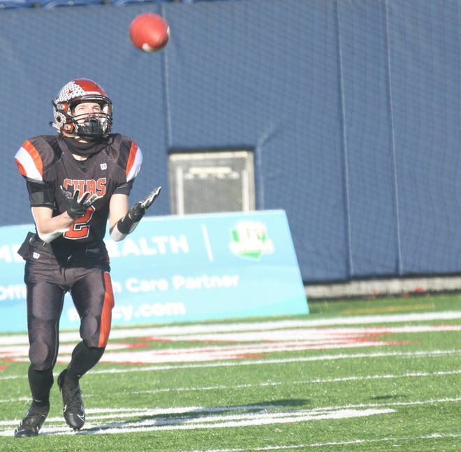 Lucas' Carson Hauger broke a 43-year old record with his 96-yard kickoff return for a touchdown in Saturday's Division VII state title game.