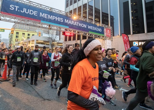 Runners make their way through downtown for the 2019 St. Jude Memphis Marathon Weekend on Saturday, Dec. 7, 2019.