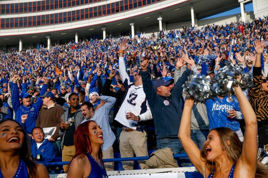Memphis fans cheer after wide receiver Antonio Gibson runs for a touchdown during the AAC championship game against Cincinnati at Liberty Bowl Memorial Stadium in December.
