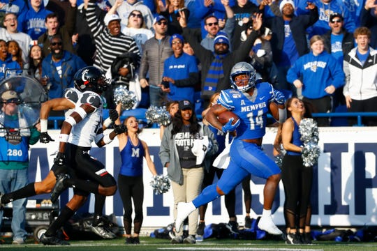 Memphis wide receiver Antonio Gibson sprints the sidelines for a touchdown against the Cincinnati Bearcats during the AAC Championship game at the Liberty Bowl Memorial Stadium on Saturday, Dec. 7, 2019.