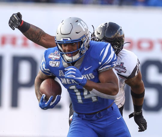 Memphis wide receiver Antonio Gibson (14) breaks away from the pack to run for a touchdown during the AAC Championship game between the Memphis Tigers and Cincinnati Bearcats at Liberty Bowl Memorial Stadium in Memphis, Tenn., on Saturday, Dec. 7, 2019.