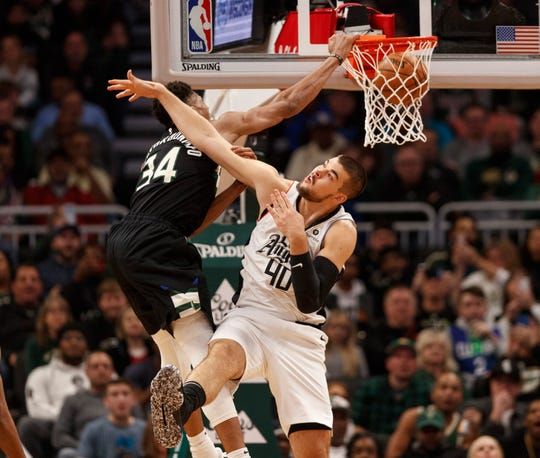 Bucks forward Giannis Antetokounmpo dunks over Los Angeles Clippers center Ivica Zubac on Dec. 6.