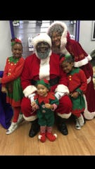 Robert and Sarhena Boyd play Santa and Mrs. Claus every year in Milwaukee, with their children, Gina-Mo'Ney, Ra'Quell and Robert Boyd III, dressed as elves. This year, their youngest child, Sabrina, will join them as well.