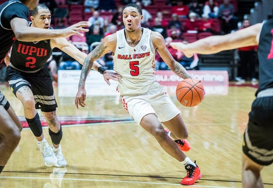 Ball State's Ishmael El-Amin slips past IUPUI's defense during their game at Worthen Arena Saturday, Dec. 7, 2019.