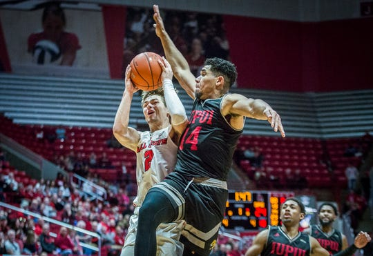 Ball State's Luke Bumbalough fights for a shop past IUPUI during their game at Worthen Arena Saturday, Dec. 7, 2019.