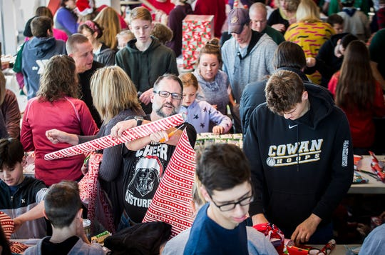 Hundreds of volunteers gathered to sort and wrap presents at Toyota of Muncie during Secret Families of Delaware County Saturday. Each sponsored family received a Christmas tree, Bible, a $50 gift card, and presents delivered to their homes by volunteers.