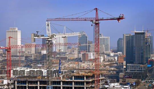 Construction cranes dominate Nashville's skyline as developers find willing buyers Saturday Dec. 7, 2019, in Nashville, Tenn.