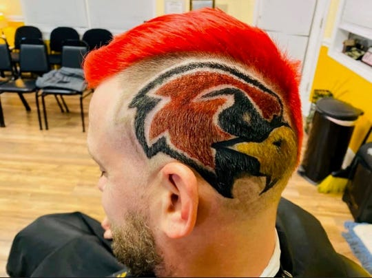Ravenwood football coach Matt Daniels has been given a mohawk, dyed it red and a Raptor placed in his head during the playoffs.