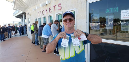 Fort Myers resident Derek DeArmond shows off the Boston Red Sox spring training tickets he purchased at JetBlue Park on Saturday, Dec. 7, 2019. DeArmond was the first in line for tickets for the 17th straight year, he said.