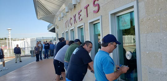 The first fans in line buy tickets for Boston Red Sox spring training games at JetBlue Park in Fort Myers on Saturday, Dec. 7, 2019. Tickets went on sale at 10 a.m., but these fans came to JetBlue on Friday to put their names on a priority list. The Red Sox used the list for the first time rather than have fans camp out over night to be first in line.