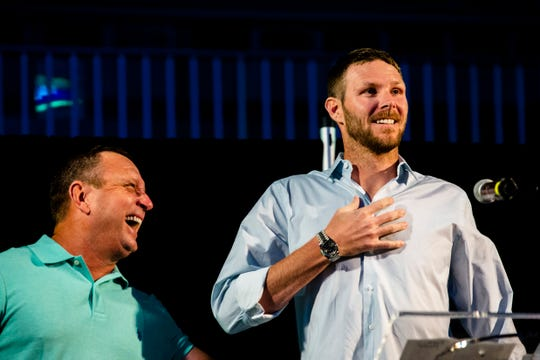 FGCU's baseball head coach Dave Tollett, left, and Chris Sale of the Boston Red Sox laugh during Night at the Nest Gala on Friday, December 6, 2019, at Alice Arena in Florida Gulf Coast University.