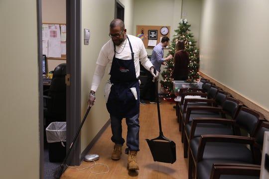Sweeping the hallway where he works as a janitor is Ralph Lee Jr. who was exonerated after spending 24 years in prison for being involved in a Paterson murder. The Innocence Project took Lee's case and found that the DNA sample, taken at the scene, did not belong to Lee. He was eventually freed and now works as a janitor at CarePlus Workforce Solutions.