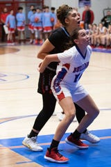 Las Cruces High's Christina Aguayo blocks out a Sandia defender during Friday's game at LCHS.