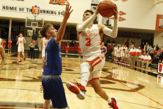 Artesia's Johntae Rodriguez goes for a fastbreak layup against Carlsbad on Dec. 6, 2019. Rodriguez scored 10 points in the game. Carlsbad won, 47-36 to advance to the championship round of the tournament.