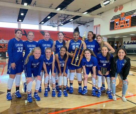 The Carlsbad Cavegirls pose after winning the Artesia City of Champions Tournament title on Dec. 7, 2019. Carlsbad defeated Grants in the championship game.