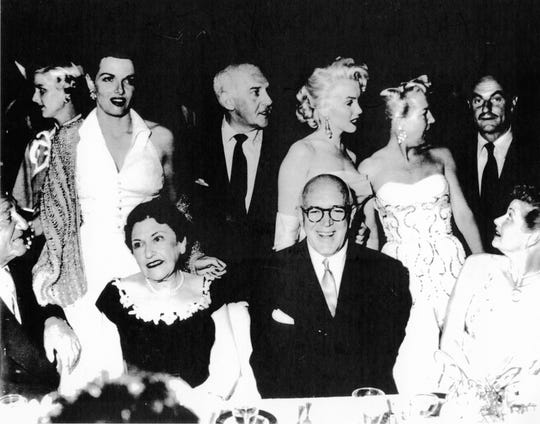 From Left to right, Jane Russell, Louella Parsons (seated), her companion Jimmy McHugh, Marilyn Monroe and Lucille Ball (seated).