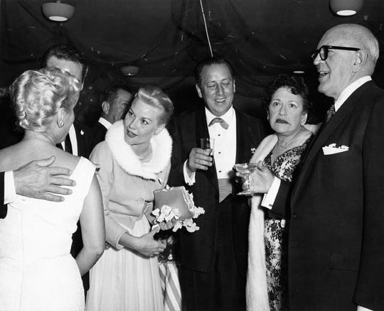 Left to right, Patti Page, owner of the El Mirador hotel Ray Ryan, Louella Parsons, Jimmy McHugh at the 1956 wedding of Patti Page at the El Mirador Hotel.